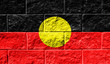 Leinwanddruck Bild - Flag of Australian Aboriginal close up painted on a cracked wall