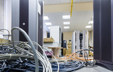 Cable Installation In The Server Room. Installation Of Equipment In A Modern Data Center, A Lot Of Intertwined Wire To Connect Internet. Large Group Of Lilac Utp Internet Cables In Data Center.