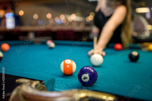 Selective focus at billiard ball on blue table Poster Mural XXL