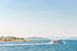 Small white ferry near saronic islands, Greece. Aegina