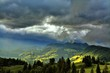 sunbeams between clouds in the mountains