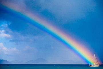 The end of a rainbow over a sailboat, St. John, USVI