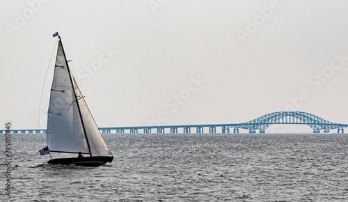 Sailboat sailing toward bridge in the Great South Bay Babylon Canvas Print