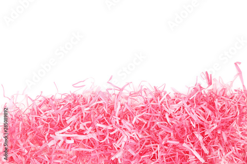 Fototapeta  Pink shredded paper on white background
