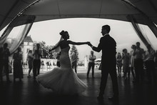 Silhouettes Of Happy Bride And...