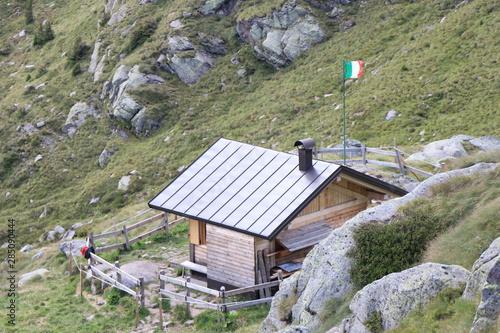 Mountain bivouac coldosè in the middle of the Italian dolomites Alps Wallpaper Mural