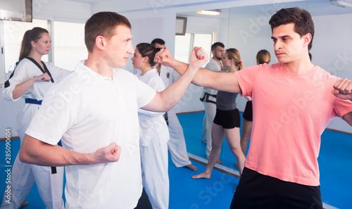 Fototapeta Taekwondo training in a mixed group obraz na płótnie