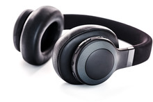 Wireless Black Headphones On White, Isolate. On-ear Headphones For Playing Games And Listening To Music Tracks. Close-up