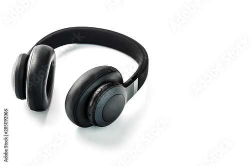 Wireless black headphones on white, isolate. On-ear headphones for playing games and listening to music tracks. Close-up - 285092066