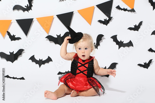 Baby girl in halloween costume on white background Canvas
