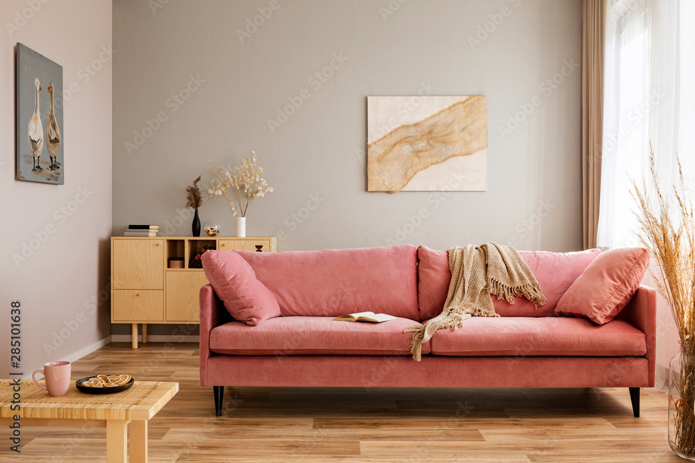 Fototapety, obrazy: Comfortable velvet pastel pink couch in elegant beige interior with abstract painting