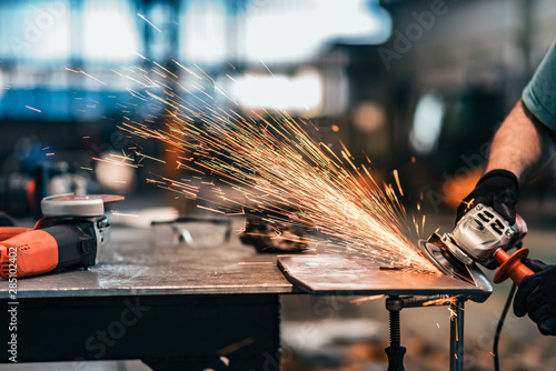 Grinding metal, sparks flying, close-up. Canvas Print