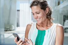 Spain, Mid Adult Woman Using Cell Phone