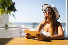 Beautiful Woman Selecting Summer Sea Destination For Holiday Vacation