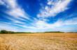 Leinwandbild Motiv Beautiful cloudy sky over summer fields