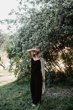 Woman Enjoying Nature In Green Trees