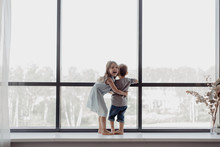 Children On Sill Looking Out W...