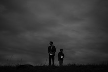 Man And Boy Standing In Empty ...