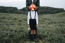Man And Boy Standing In Field ...