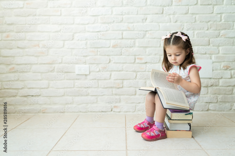 Fototapety, obrazy: Toddler Learning To Read Books At Home