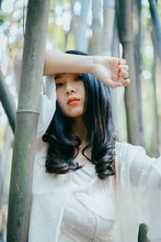 Portrait Of Fashion Asian Woman In Bamboo Forest