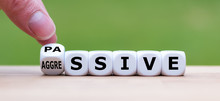 """Hand Turns A Dice And Changes The Word """"passive"""" To """"aggressive"""", Or Vice Versa."""