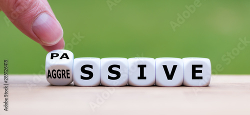 Valokuvatapetti Hand turns a dice and changes the word passive to aggressive, or vice versa