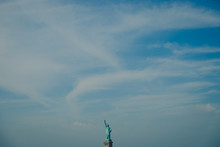 Amazing View Of Blue Sky Of Manhattan With The Statue Of Liberty On Background