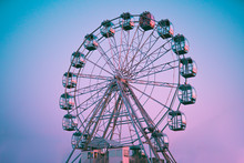 Ferris Wheel Against The Background Of The Summer Sky