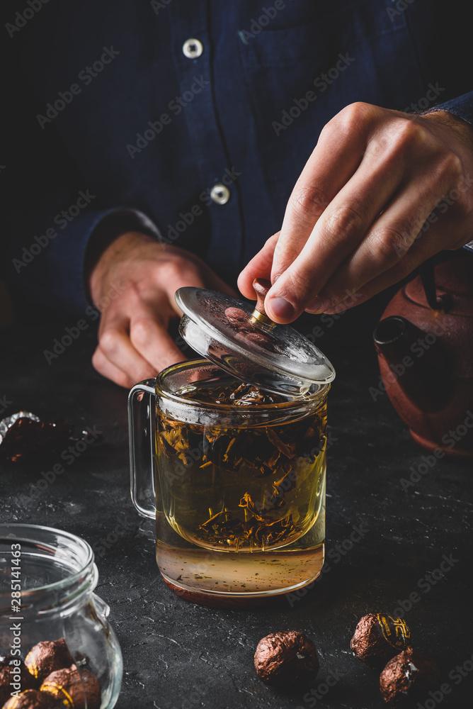 Fototapety, obrazy: Steeping red tea in glass mug