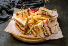 Club Sandwich With Fries On Black Concrete Table