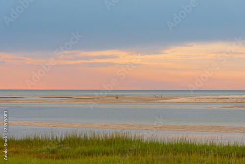 Vacationing Tourists Enjoy the Cape Cod Bay under a Pastoral Pastel August Sunse Canvas-taulu