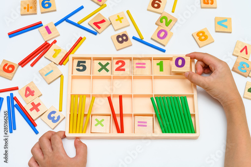kid doing multiplication equation using counting rods Wallpaper Mural