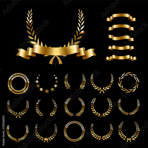 Fotografija Golden laurel wreaths and ribbons set on black background
