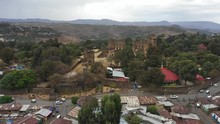 Establishing Drone Shot Of Historic Fasil Ghebbi Fortress Set On Strategic Hilltop In Gondar, Tourism And Cultural Heritage Ethiopia