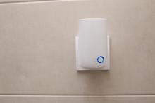 Wifi Home Repeater Plugged In Closeup.