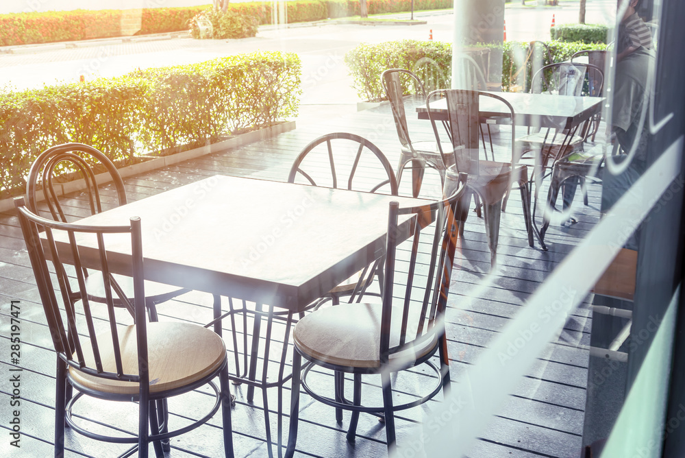 Fototapety, obrazy: Outside shop in sunny day with tables and chairs of cafe , restaurant in the morning time which nobody uses them  .Outdoor of coffee shop exterior design concept