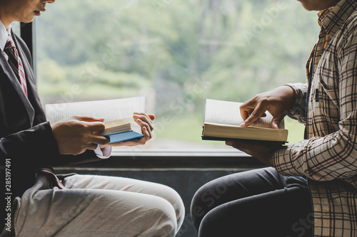 Fotografia  Christians and Bible study concept.Two men studying the bible.
