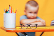 boy sitting ubfocused glasses in focus. Concept problem of ophthalmology correction of myopia. back to school. Selective focus. upset child