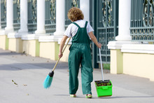 Janitor Cleans The Sidewalk Of...