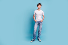 Full Length Body Size Photo Of School Boy Posing In Front Of Camera Being Photographed For School Album While Isolated With Blue Background