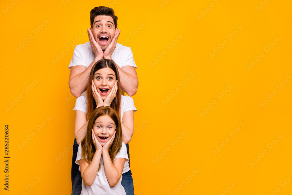 Fototapety, obrazy: Portrait of three nice attractive charming lovely cute careful cheerful cheery stunned person in order of hierarchy unexpected great news isolated over bright vivid shine yellow background
