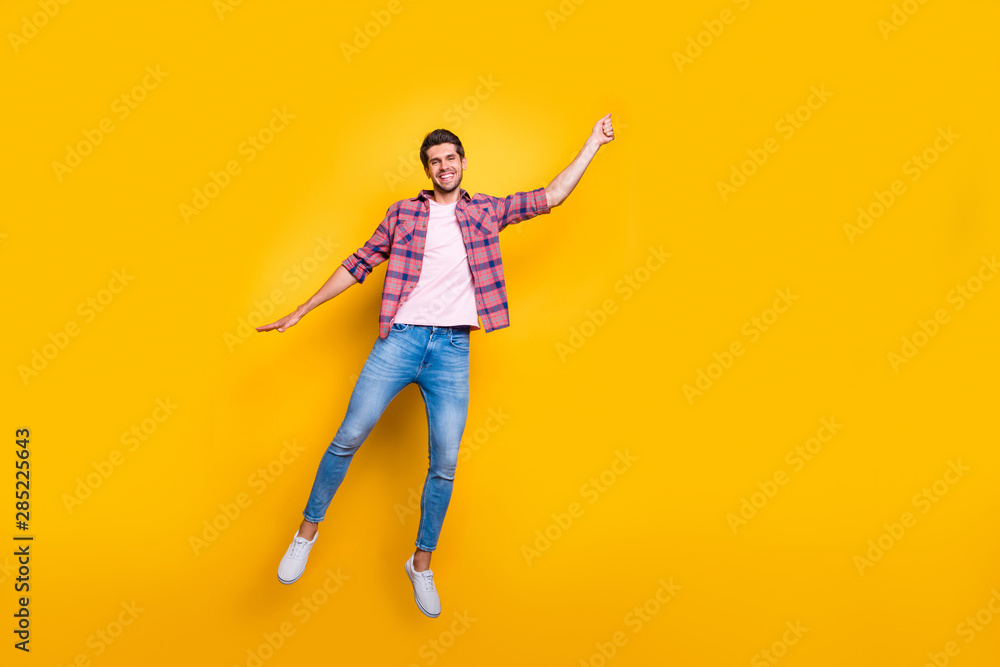 Fototapety, obrazy: Full length body size photo of rejoicing overjoyed enjoying man wearing jeans denim pretending to be holding balloon and flying with it isolated with vivid background
