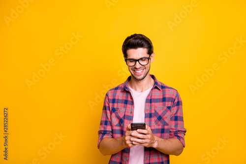 Photo of toothily smiling man seeing his interlocutor send him selfie while isol Wallpaper Mural