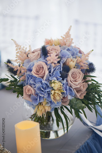 Valokuva  Bouquet of the bride with a powdery rose and blue hydrangea