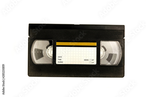 Foto  Large picture of an old Video Cassette tape on white background