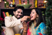 Indian Smart Couple Eating Swe...