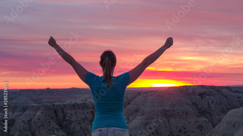 Keuken foto achterwand Lavendel CLOSE UP: Cheerful young woman on top of the mountain celebrating at pink sunset