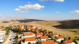 Small town with red rooftops Close to the desert Aerial view Drone shot of Houses Close to the desert in Israel city of Maale adumim