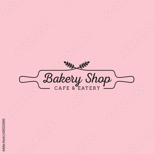 Fotografia  Simple feminine bakery logo design with wheat and wood rolling pin